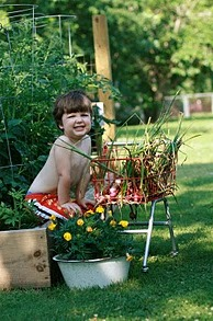 Kids should garden because it's fun, as this smiling boy shows.