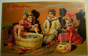 kids bob for apples in vintage halloween card