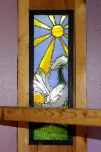 chicken motif on stained glass
