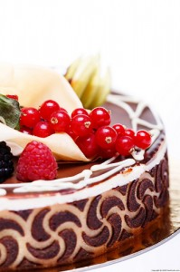 Fresh berries atop a chocolate cake