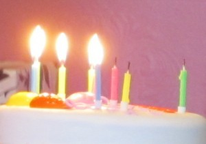 bright candles on a white cake