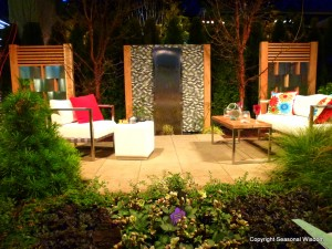 outdoor space with wall fountain and contemporary furniture