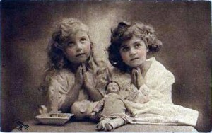 vintage cards from early 1920s, two girls praying. Summer solstice was a scary time in past.