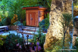 Zen-style garden at the Northwest Flower and Garden Show, with boulders, conifers, living roof and tiny wooden house