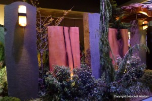 Giant slabs of purple and mauve rocks make privacy wall at 2013 northwest flower and garden show