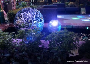 blue disco-inspired balls in stone pond