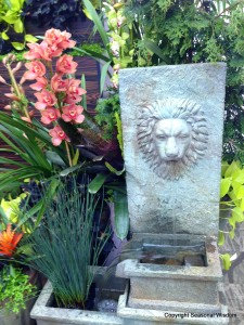 lion fountain with orchids