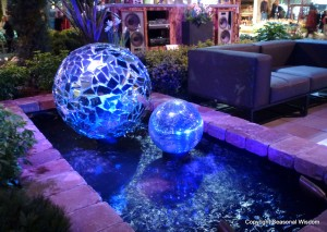 Giant blue balls in water garden