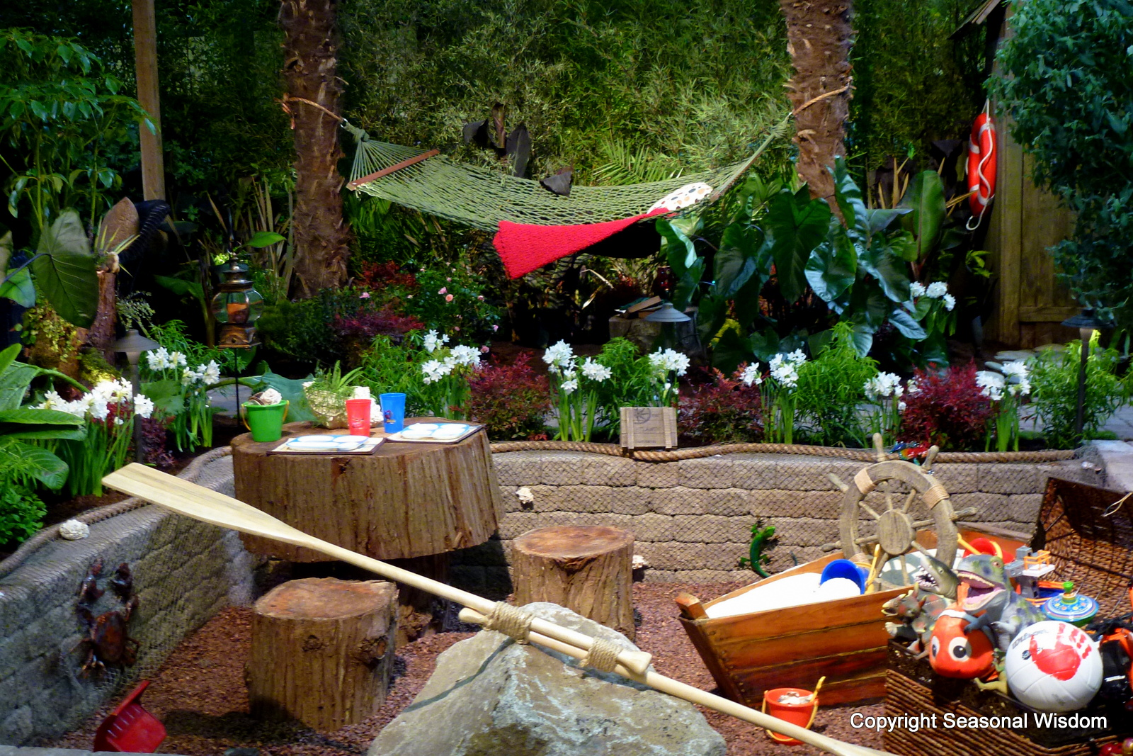 kids garden with sandbox teeter totter and table and chairs made from a tree - Garden Design Kids