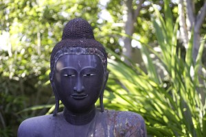 A four-foot buddha is part of the garden designed by Billy Goodnick.