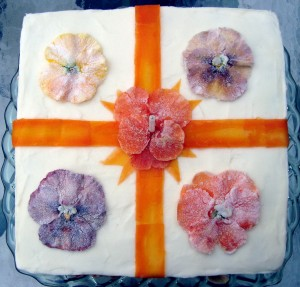 Distopiandreamgirl - candied pansies are edible flowers that look lovely on a carrot cake