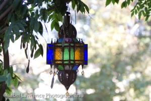 A colorful lantern hangs from the pergola on Billy Goodnick tour.