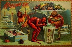 Halloween devils get into the candy in this vintage halloween card