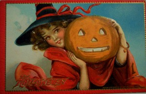 A cute little girl holds a jack o'lantern in this vintage halloween card