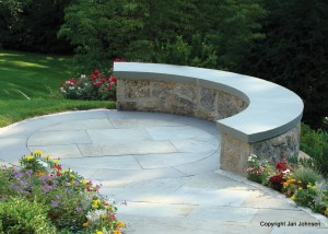 A curved bench and circular patio make a great power spot in the garden.