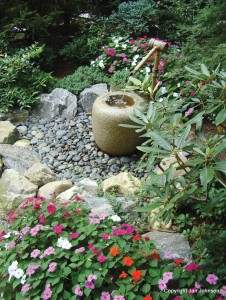 A simple fountain with rocks makes a nice power spot in the garden.