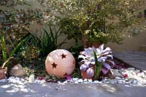 Garden art and succulents in water-wise garden