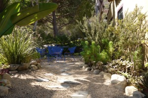 Water-wise garden with rocky path to outside table