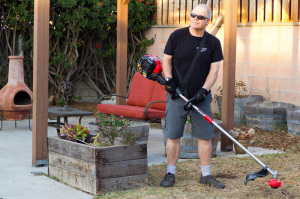 troy-bilt trimmer being used