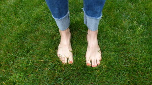 Feet in grass from The Cancer Survivor's Garden Companion