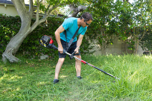 man with brush cutter