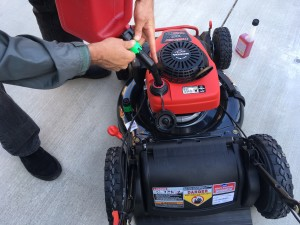 adding gas to a troy bilt lawn mower