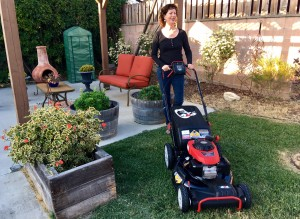 woman and troy bilt lawn mower